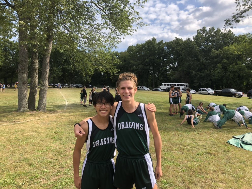 Seniors Hong Bing Tang (left) and Clayton Kuiper following the Dragons' victory in the Averill Invitational at Kensington Metropark on September 11. Kuiper finished in second-place individually at 16:44, while Tang was right on his heels in third-place at 16:46.
