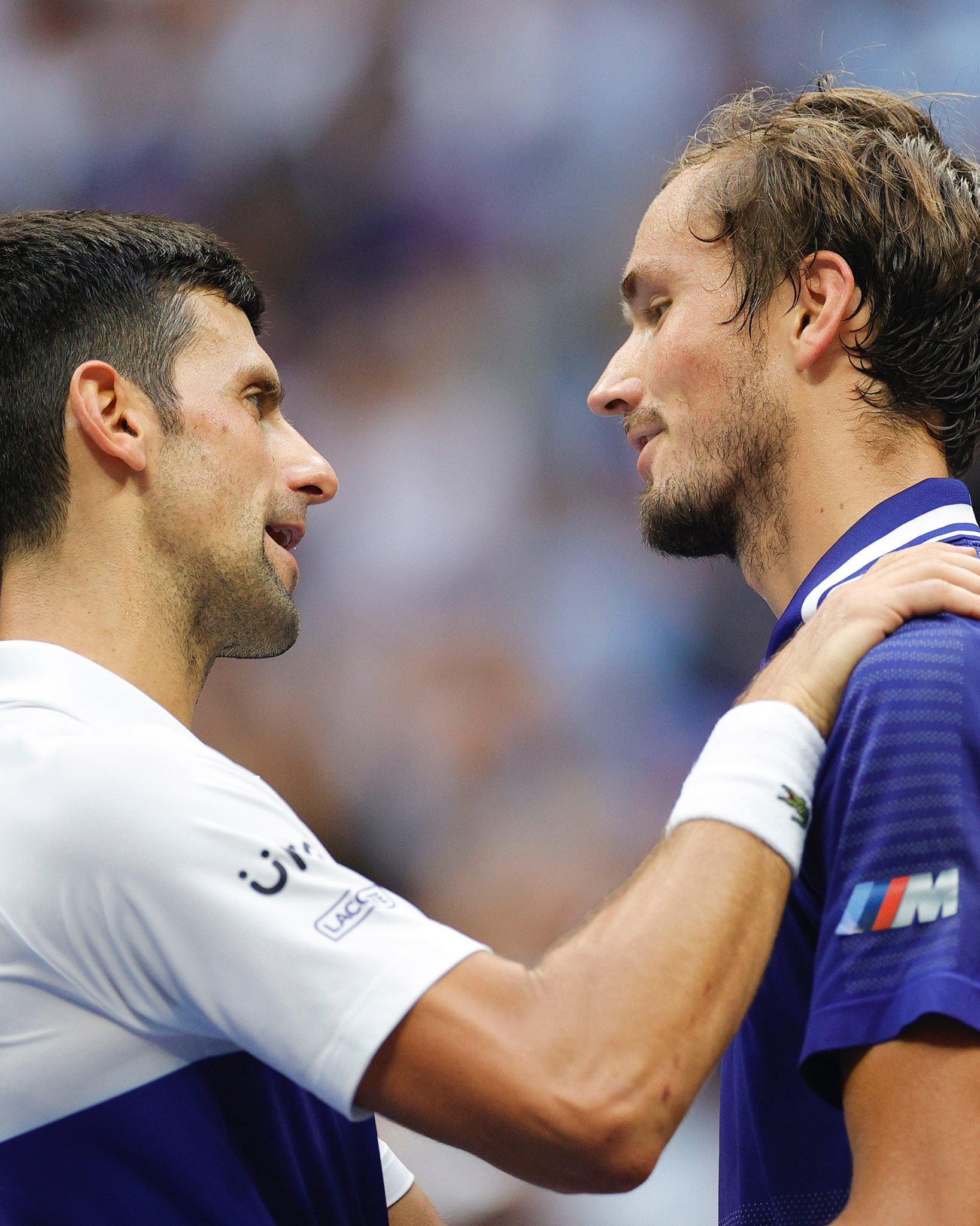 Daniil Medvedev (R) of Russia and Novak Djokovic (L) of Serbia talk at center court after Medvedev won their Men's Singles final match on Day Fourteen of the 2021 US Open at the USTA Billie Jean King National Tennis Center on September 12, 2021 in the Flushing neighborhood of the Queens borough of New York City.