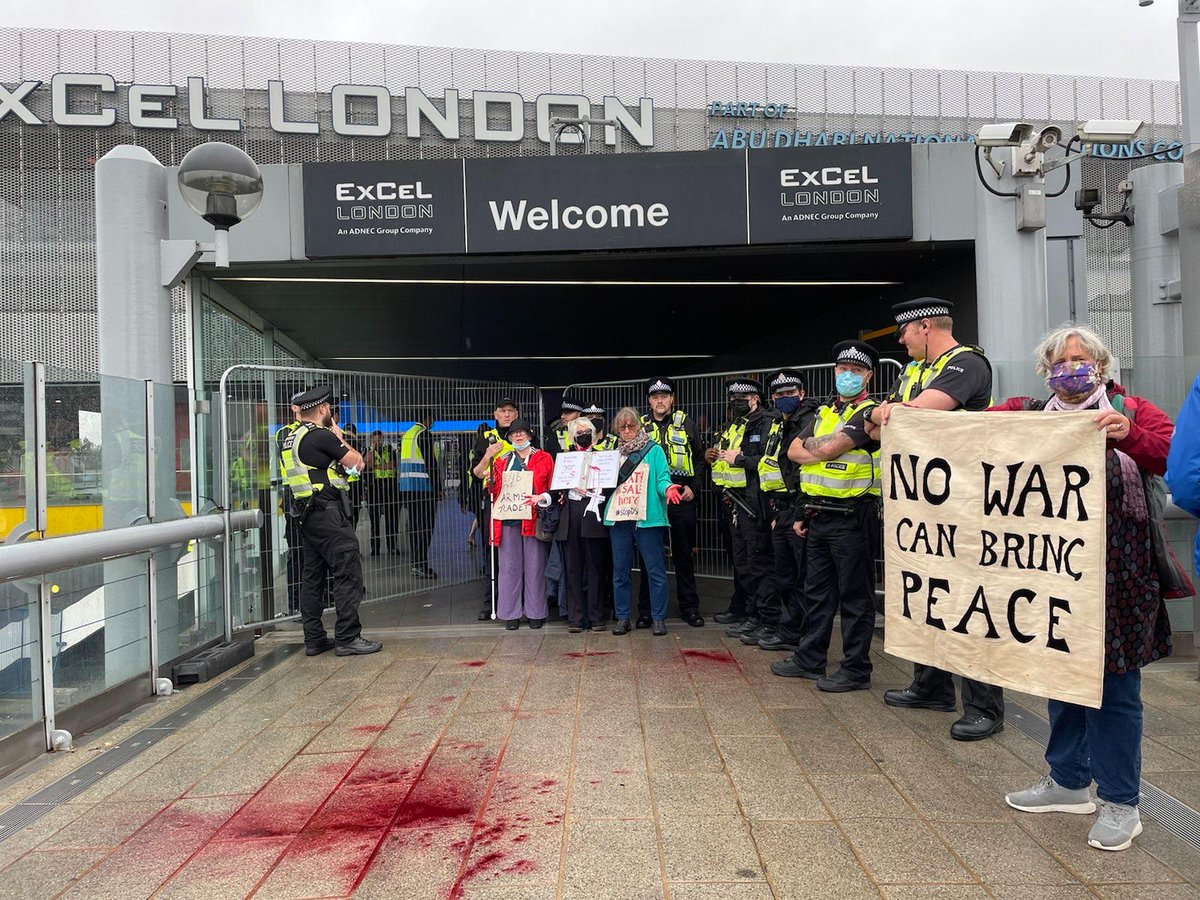 As well as holding space at the main entrance, Quaker Roots activists have been blocking the entrances to DSEI from the DLR stations.   #StopDSEI @StopTheArmsFair @londoncaat @CAATuk @BritishQuakers @HuddsQuakers @PutDownTheSword