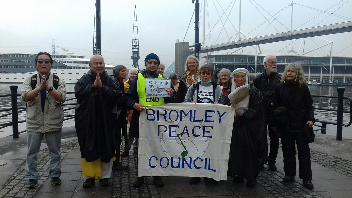 Bromley Peace Council lays a wreath in memory of the victims of wars in front of the Excel Centre, while inside, the #DSEI2021 Arms Fair continues.   This is where war begin.  This is where we can stop it.   #StopTheArmsFair