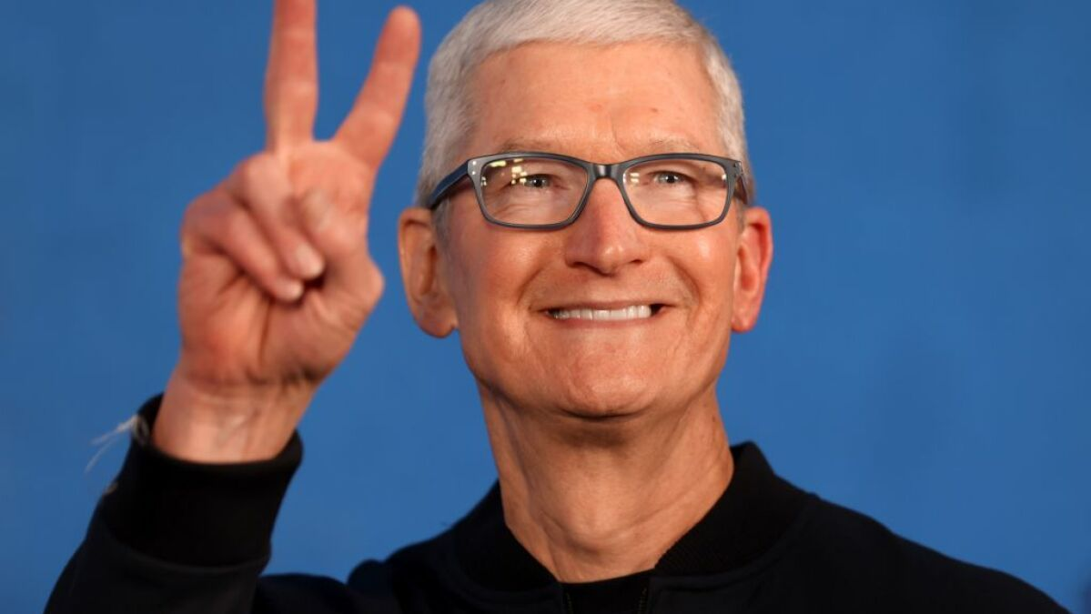 CEO Tim Cook told employees medical insurance would help cover out-of-state expenses.