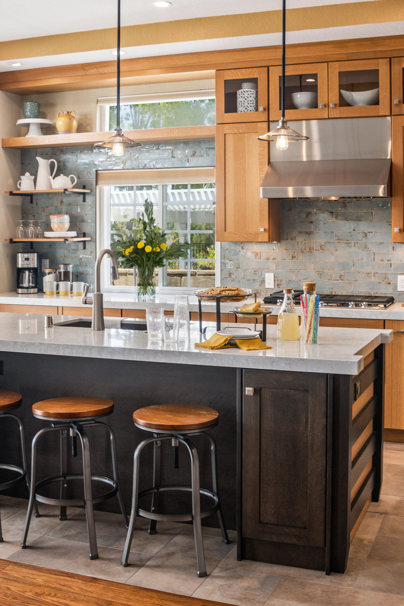 The backsplash gives this kitchen a nice shot of color with a distressed texture.(Countertops: @Silestone)