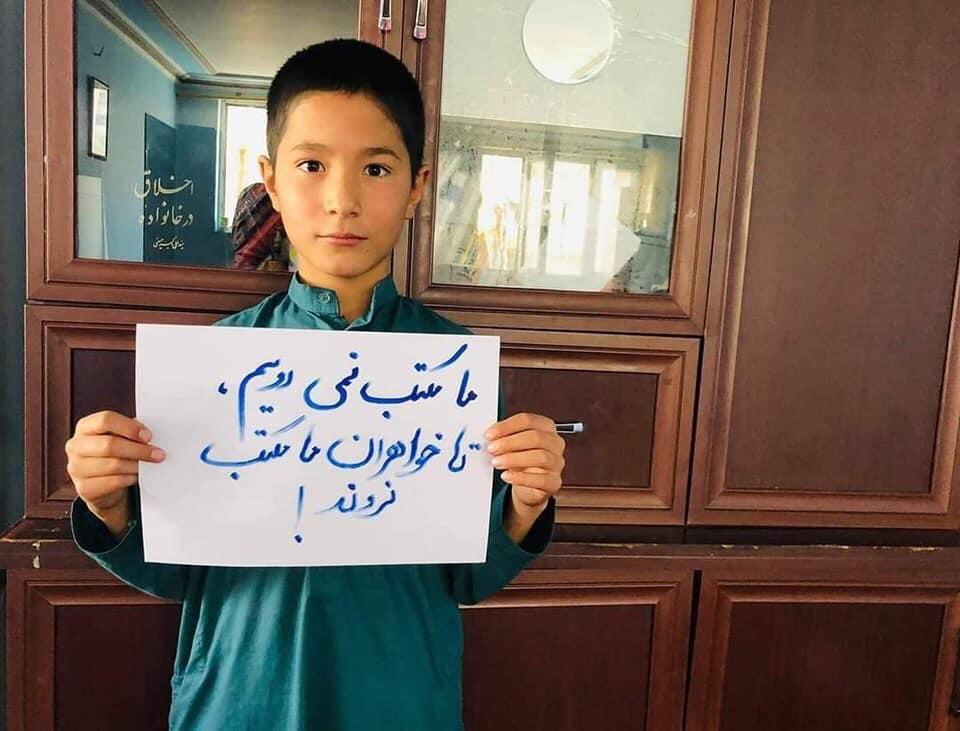 """The Taliban have prohibited girls from secondary school in Afghanistan. In solidarity, many boys have been refusing to go to school themselves. """"We don't go to school without our sisters"""", reads this sign."""