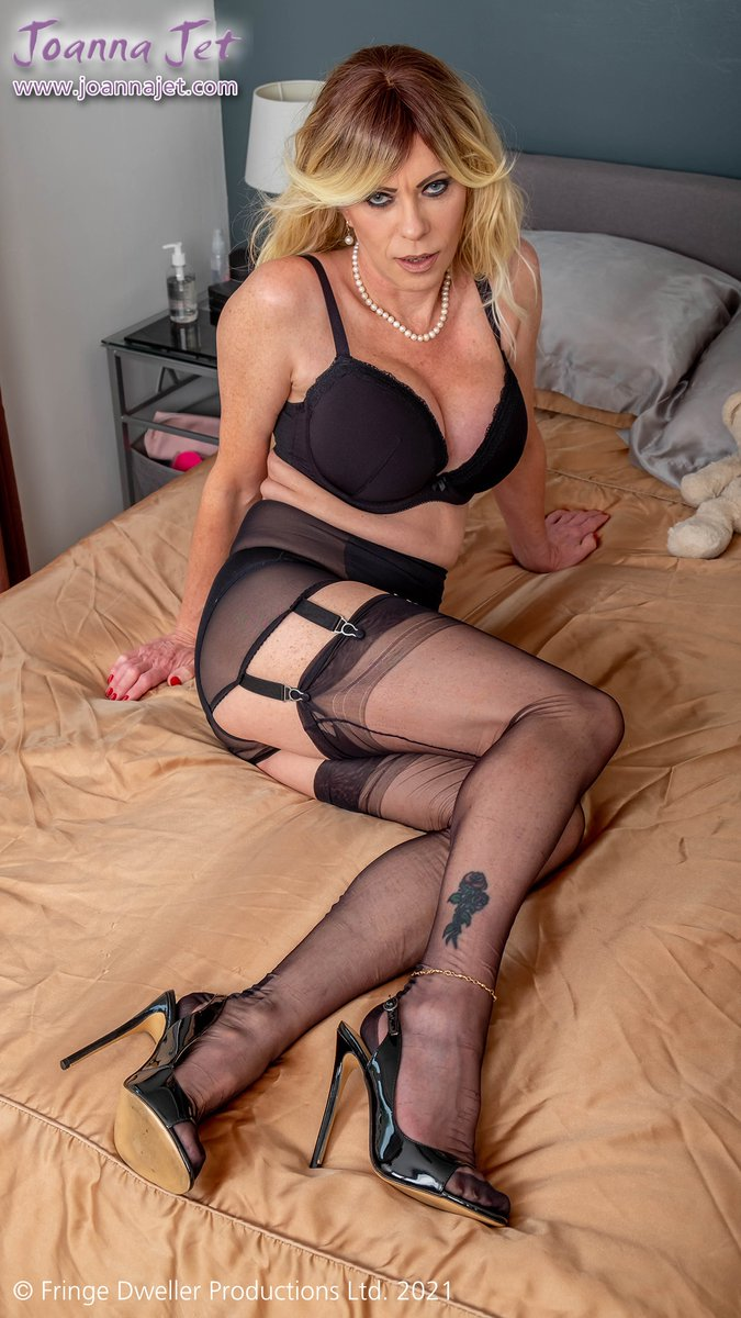 One pic from the last set on joannajet.com✨ Joanna says: 'A low cut blouse, miniskirt, sheer lingerie, fully fashioned stockings and slingback sandals for that classic MILF look ;-) xxx'