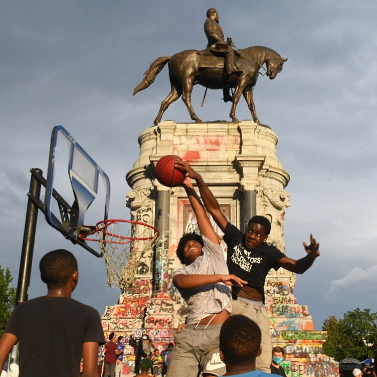 Boys play basketball on a makeshift court at the Robert E. Lee Monument. Photo by Scott Elmquist.