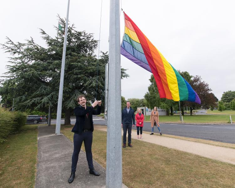 🏳️‍🌈👨‍⚕️ @DublinPride joint Grand Marshall Dr John Gilmore raises the Pride flag on campus  🚑 Since March, John, an Assistant Professor at @ucdsnmhs, has been balancing his full time academic duties with clinical practise on the ICU at St Vincent's University Hospital https://t.co/6VvcrlH0lI https://t.co/J31S9DxZST