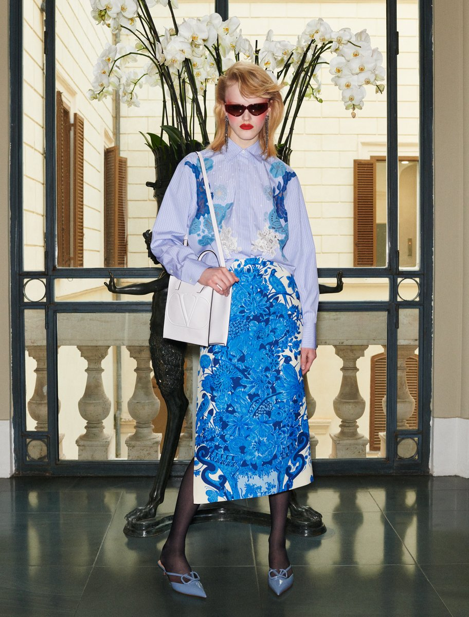 Valentino Garavani accessories meet a Couture aesthetic with a blue and white outfit from the #ValentinoBluegrace selection of items from #ValentinoFW20 by #PierpaoloPiccioli. Discover more at m.valentino.com/go/Bluegrace