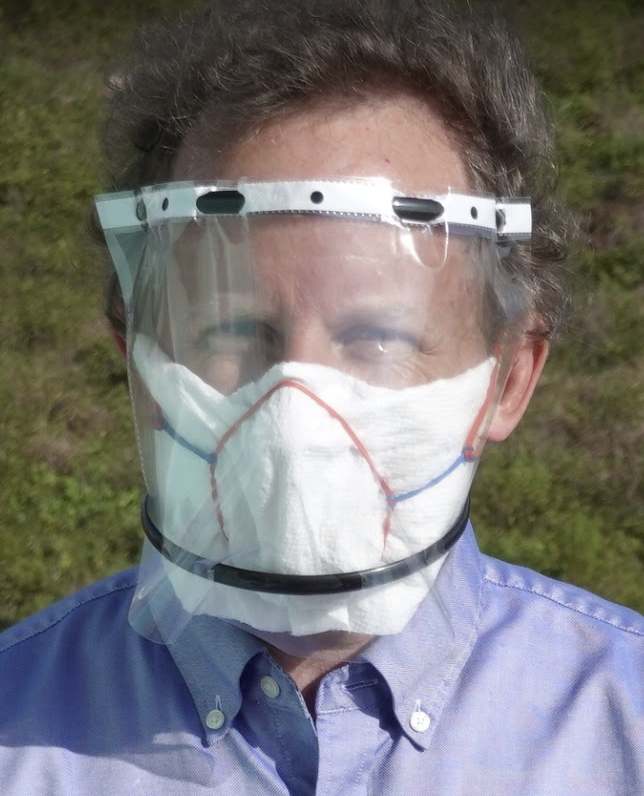 "Q: How about face shields?A: Face shields are not well studied, but are probably a useful addition. Here's my ""maxed out"" face covering, using paper towel, foil nose piece, rubber bands, a transparent file folder, and hair bands. Took 5 mins, required no tools, cost $0.65"