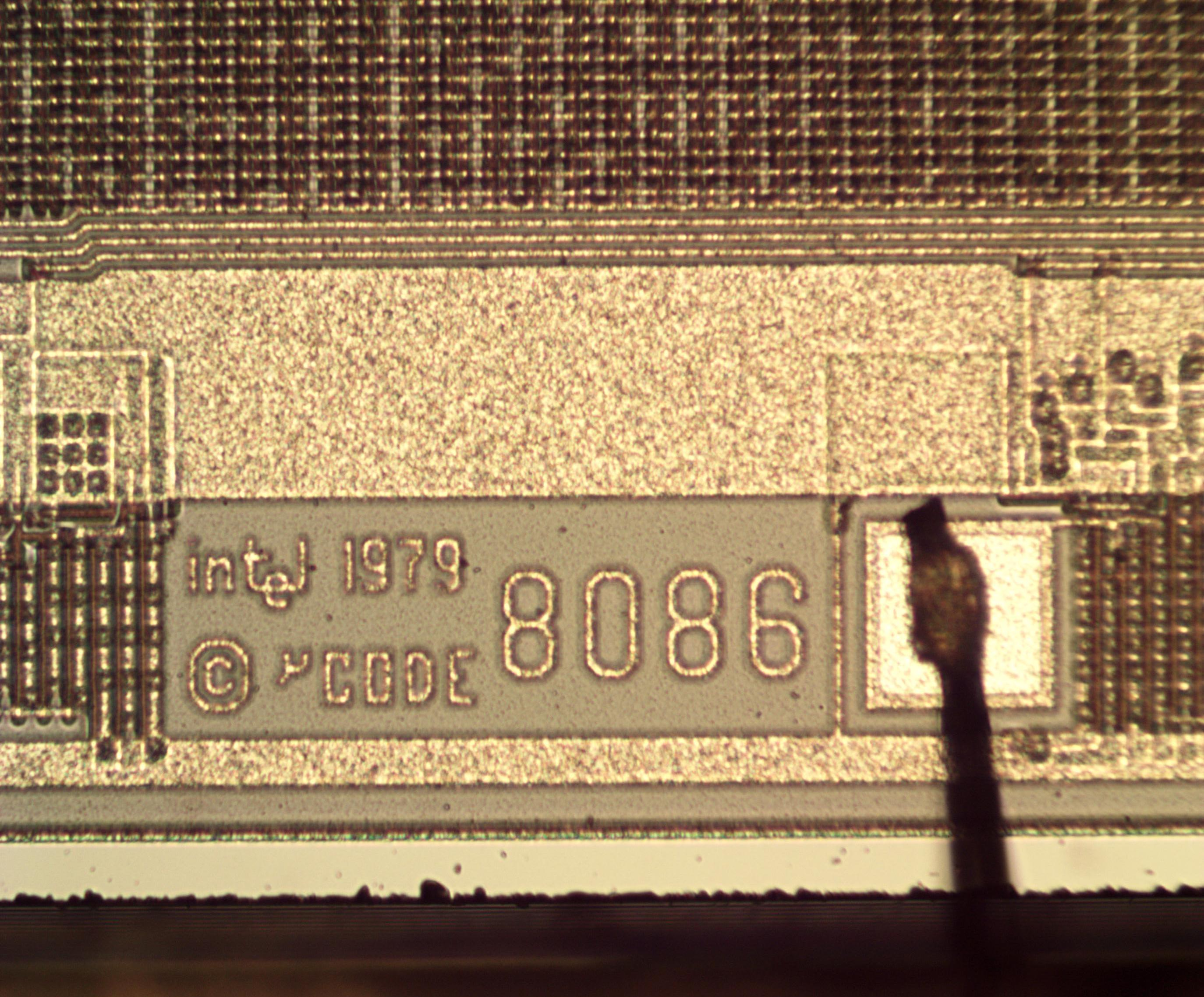 "Detail of the 8086 die showing text: ""intel 1979 © μCODE [i.e. microcode] 8086""."