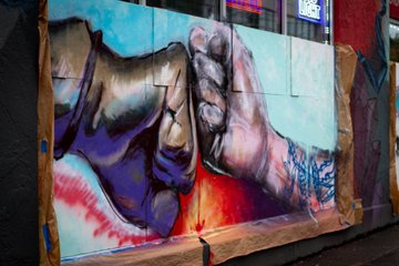 mural of a fist bump