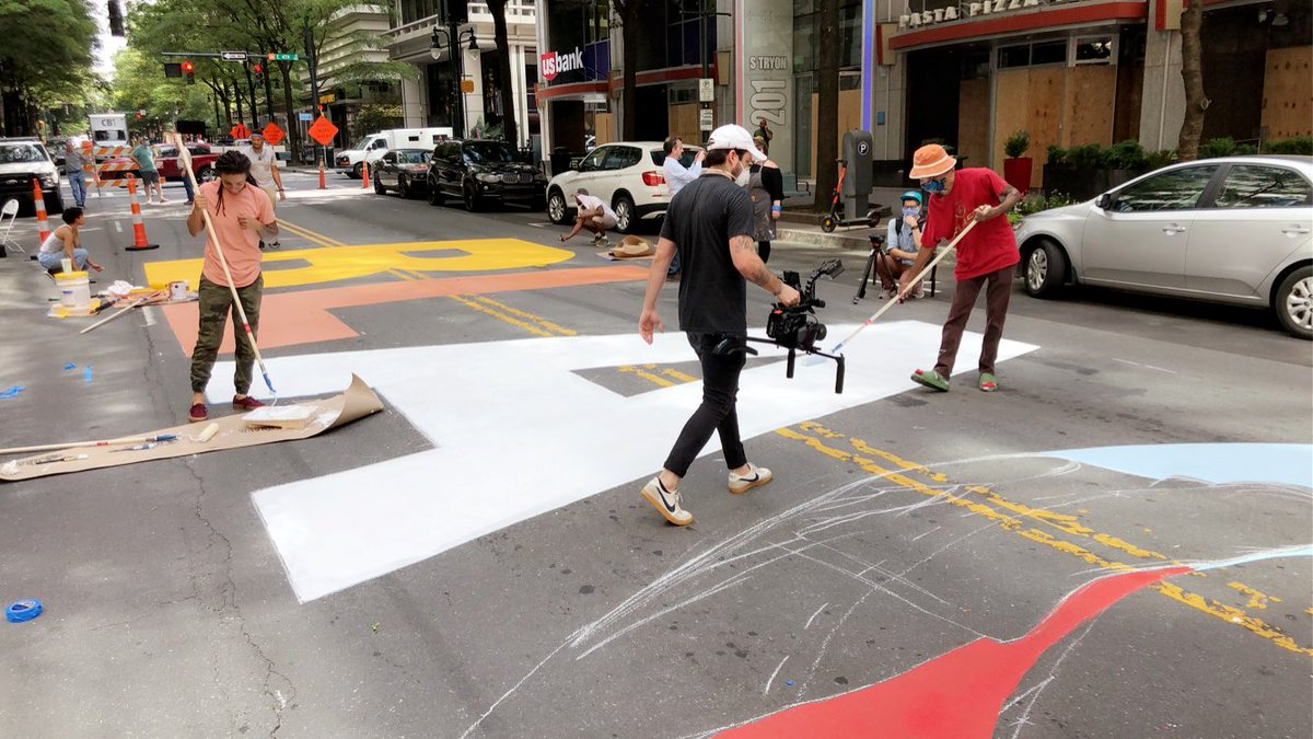"""""""Sometimes words fail you"""" One spectator trying to describe how she felt seeing dozens of artists painting the words Black Lives Matter on S. Tryon Street in Uptown Charlotte. Each letter has an individual artist leading the effort to post their own design. #BLM https://t.co/uDjOapwp9Q"""
