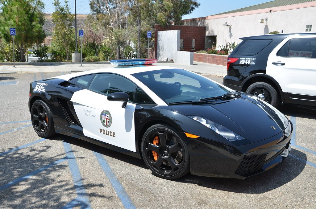 """Replying to @peter_miller: The official car of """"defund the police"""" is this LAPD Lamborghini parked in a disabled spot"""