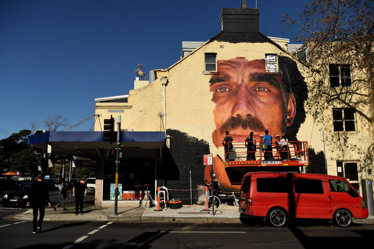 A mural of Adam Goodes is being painted on the wall of a building on the corner of Foveaux St and Crown St in Surry Hills. The artists have been commissioned by the building owner.  Photos by @geraghtyk https://t.co/NWQszaViVa