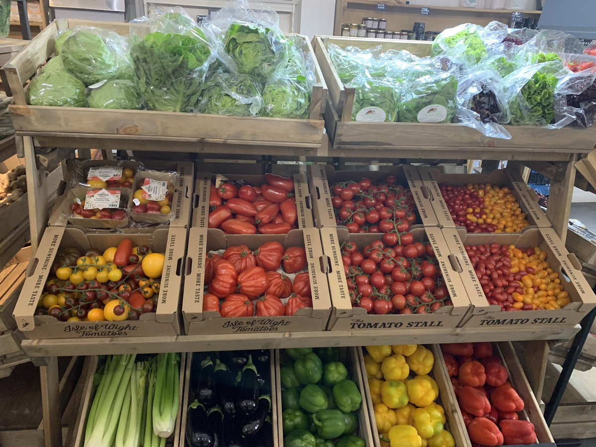 Nice way to show off our new shelf full of colour #iowtomatoes #shoplocal #linkshelving
