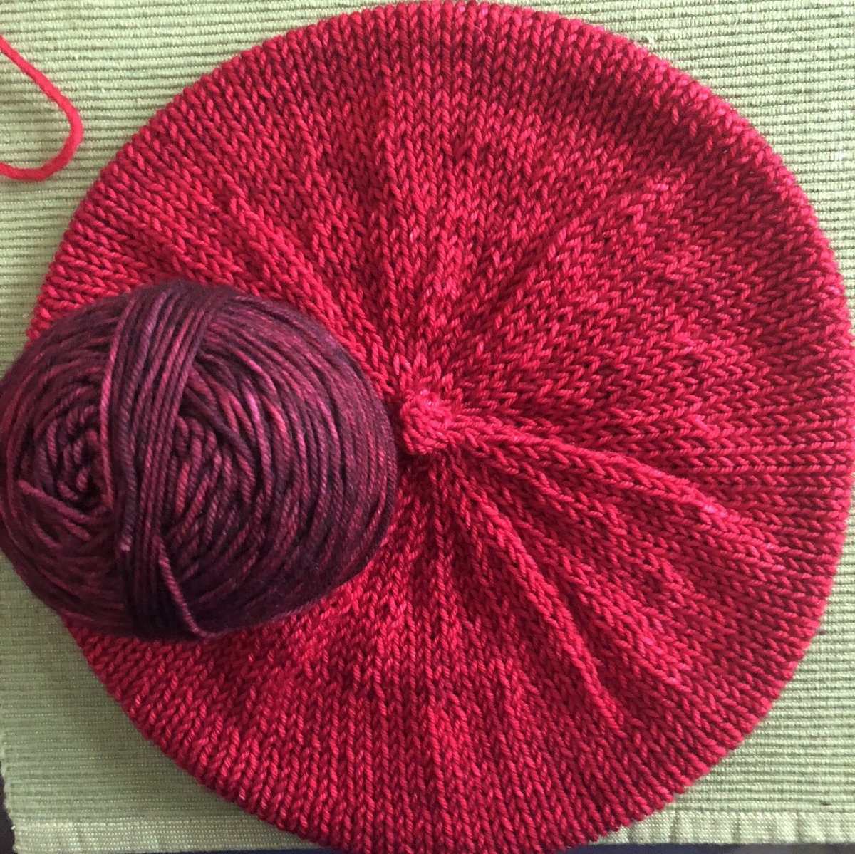 .@TinaDesireeBerg I have to admit to my procrastination—I'm so sorry! And also, my son really wanted to give the deeper shade that I at first showed you, to his teacher for end of year. So I can mail you this truer red, or, I can knit it the original shade, you just have to wait!