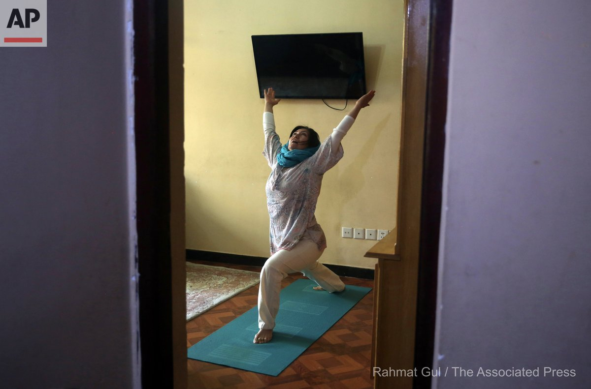 Fakhria Momtaz, 43, founder of Kabul's first yoga center, records a free online class for her students from her home during the COVID-19 pandemic lockdown, in Kabul, Afghanistan, Tuesday, June 16, 2020. (AP Photo/Rahmat Gul) https://t.co/Nqch0tOXLE
