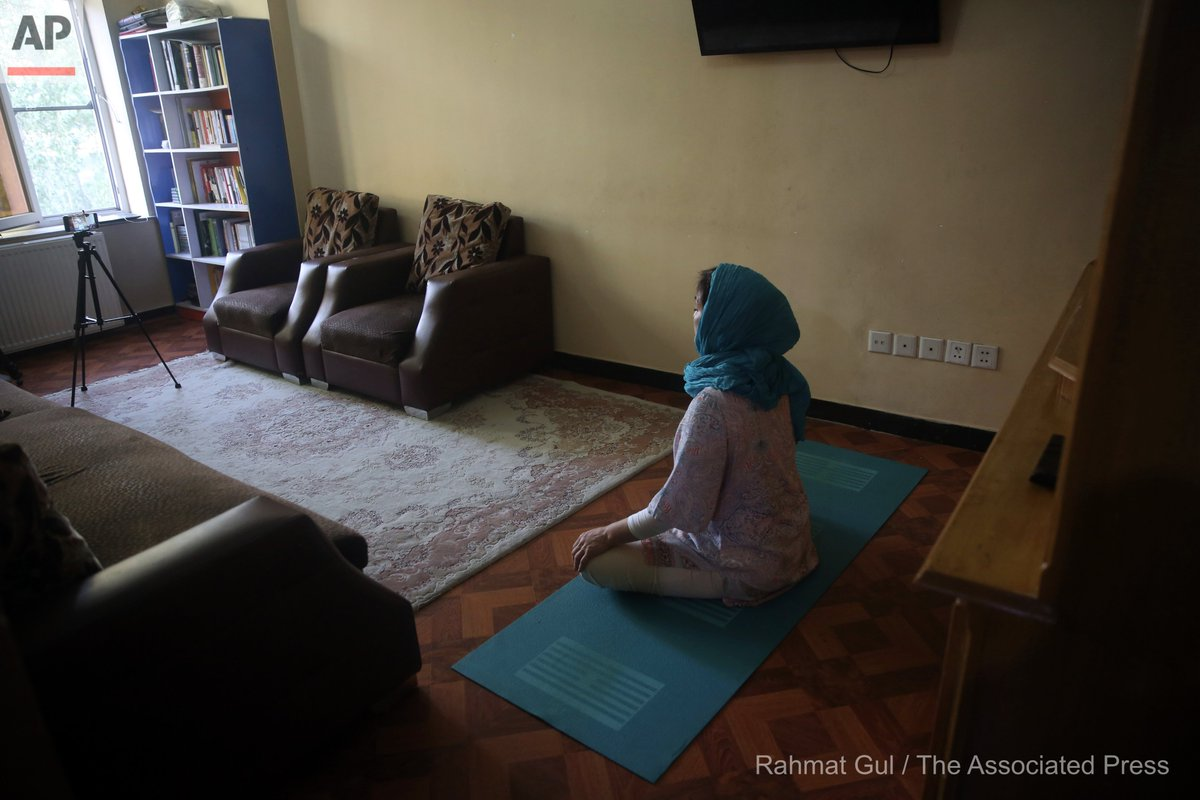 Fakhria Momtaz, 43, founder of Kabul's first yoga center, records a free online class for her students from her home during the COVID-19 pandemic lockdown, in Kabul, Afghanistan, Tuesday, June 16, 2020. (AP Photo/Rahmat Gul) https://t.co/1I45sVYw67