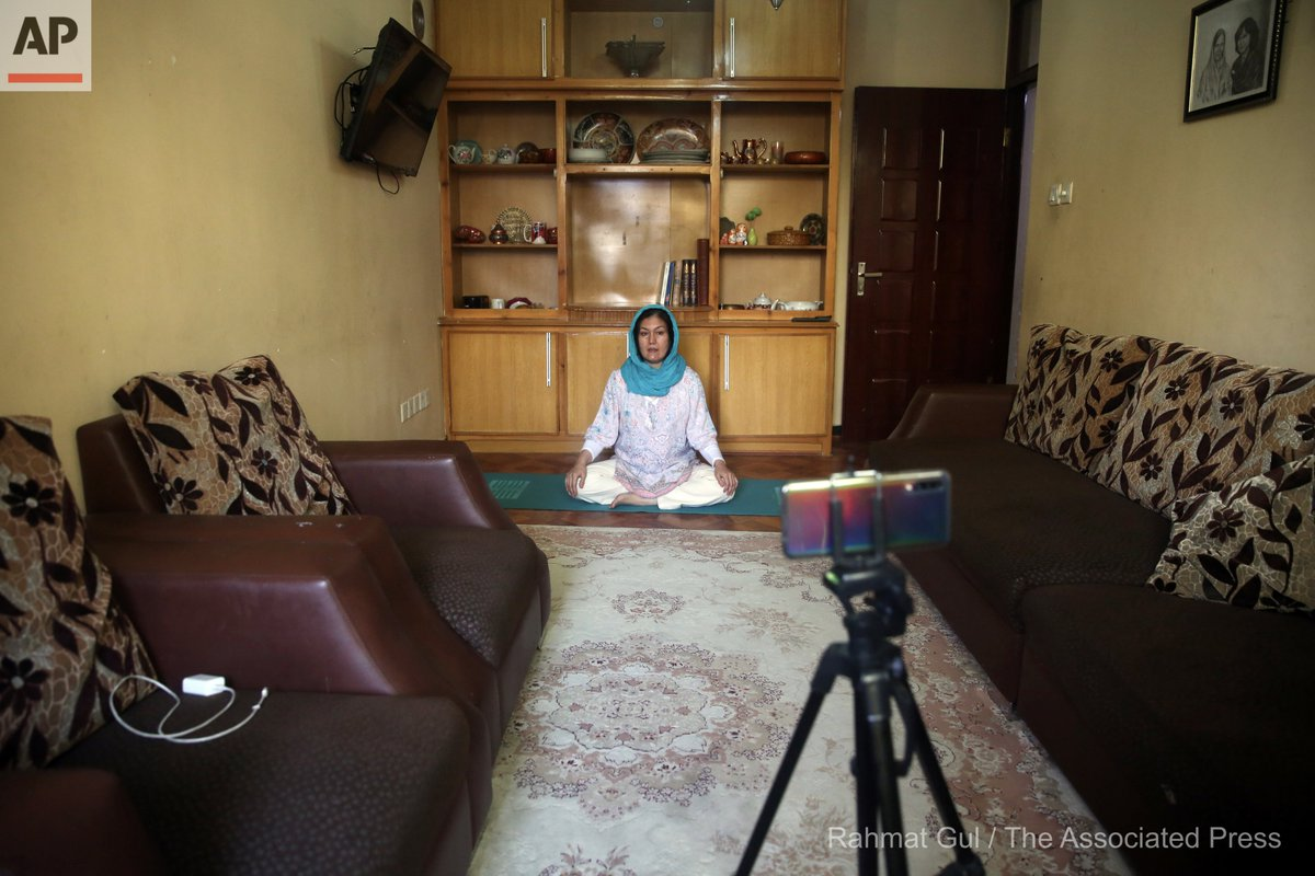 Fakhria Momtaz, 43, founder of Kabul's first yoga center, records a free online class for her students from her home during the COVID-19 pandemic lockdown, in Kabul, Afghanistan, Tuesday, June 16, 2020. (AP Photo/Rahmat Gul) https://t.co/b5Pi80DVI1