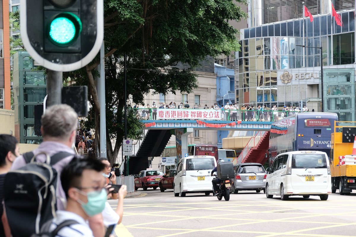 """Not sure if """"celebrate #HongKong reunification and implementation of #NationalSecurityLaw"""" banners popping up everywhere recently are approved by the authorities. Similar pro-govt banners were also hung on the streets during #antiELAB protest last year. https://t.co/kOyUm3XANH"""