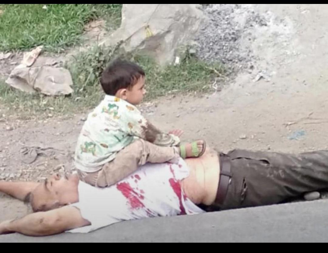 What do expect this child to do when he grows up! A numb grandchild sitting on his dead grandfather who has been officially killed due to a gun-fight between militants and security forces in Kashmir, while family says he was pulled out of his car by security forces and killed. https://t.co/3LtLq1a1v2
