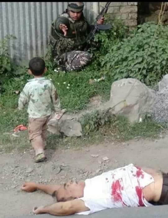 A child caught up between his grandfather's bullet-riddled body and the gun-weilding soldiers. No image can describe the plight of Kashmiris with such grim precision. #kashmirBleeds https://t.co/WWZslaTiGn