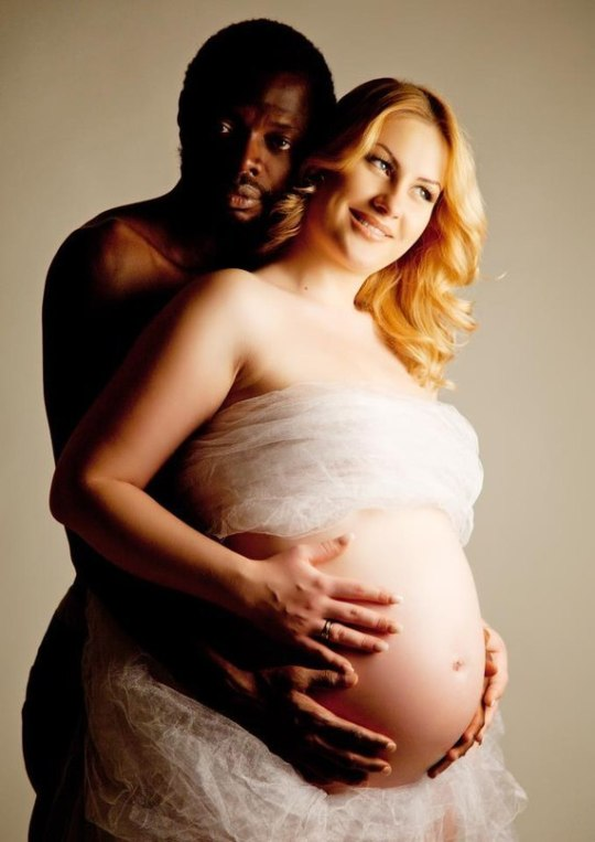 Black Man With Pregnant Caucasian Wife Stock Photo