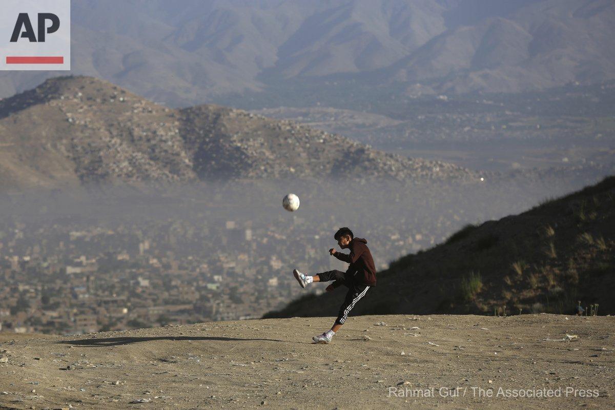An Afghan young boy plays football amid the COVID-19 pandemic lockdown, on the outskirts of Kabul, Afghanistan, Sunday, June 21, 2020. (AP Photo/Rahmat Gul) https://t.co/nJ2KWsU6c9