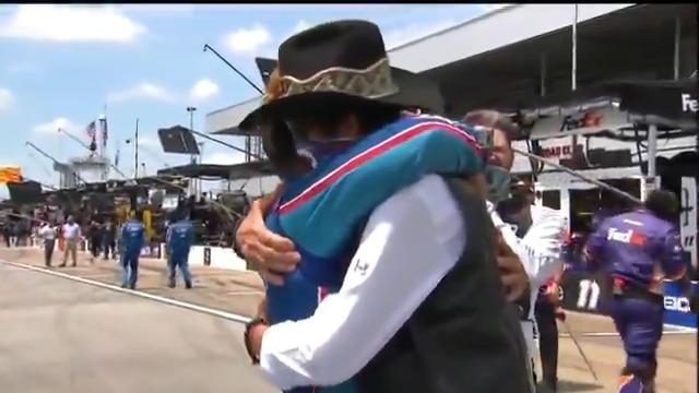 Bubba Wallace gets a hug from Richard Petty