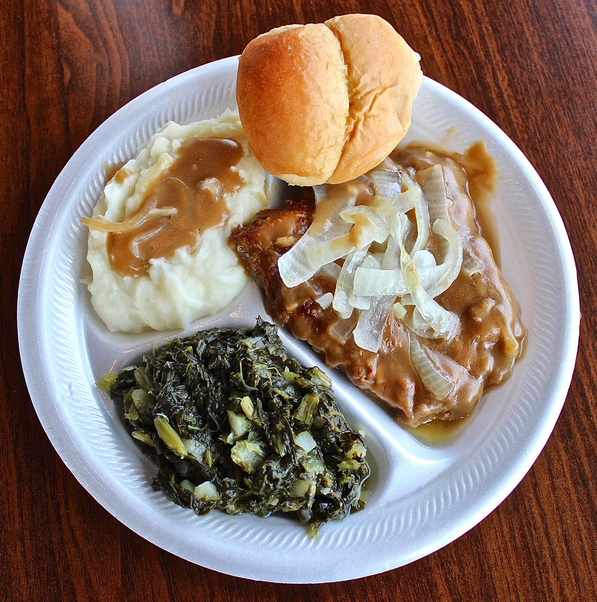 Join us for lunch or dinner today and try our smothered pork chops. Made with lots of love like our made-from-scratch mashed potatoes and turnip greens!! 🤗 #WednesdaySpecial #BishopsMeat3