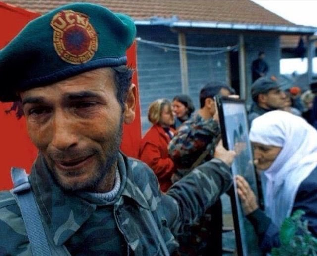 Kosovo Liberation Army (KLA) soldier mourns the loss of a fellow Albanian, killed by Serbian forces during the Kosovo Genocide.    #NeverForget <br>http://pic.twitter.com/tghFA91HsB