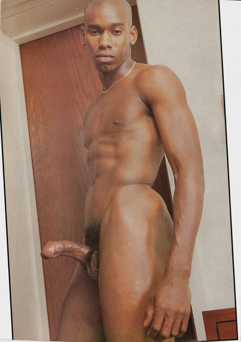 Naked black guy posing