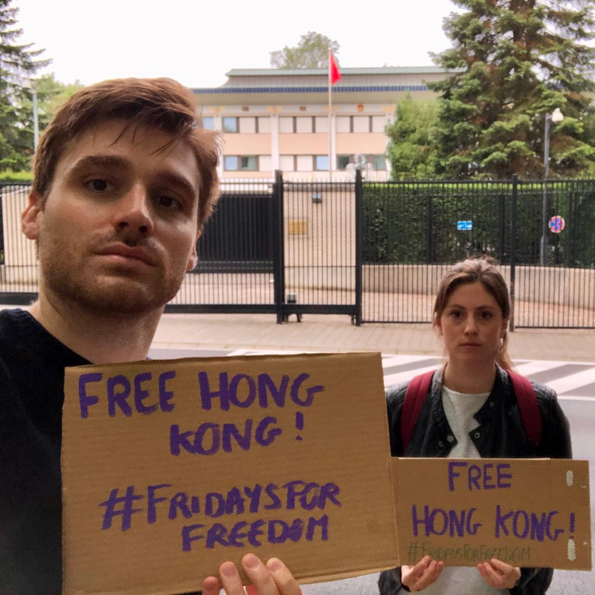 """Activists from all over the world are taking part in our #FridaysForFreedom action to stop the #NationalSecurityLaw.  Take a picture with a sign saying """"#FreeHongKong"""" in front of a Chinese Embassy (or in your living room)!  Download here the SM package: https://t.co/OA8coqEumB https://t.co/lPQNsTsJVJ"""