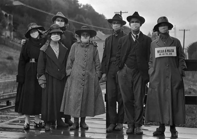 """A patient sent me this photo from the 1918 Pandemic. The sign says """"Wear A Mask or Go To Jail""""."""