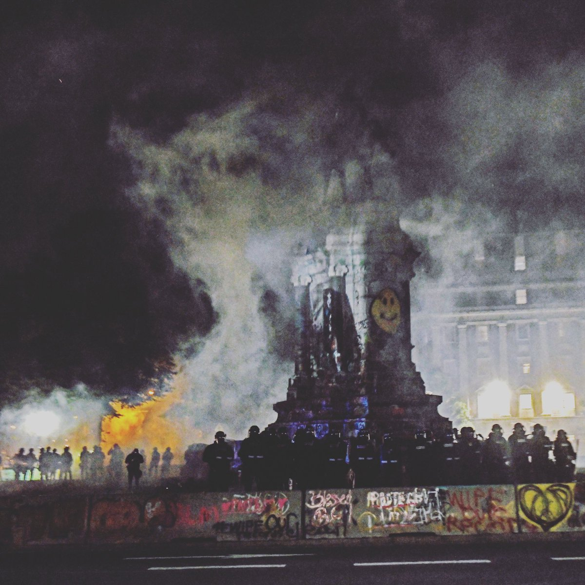 The Robert E. Lee Monument engulfed in tear gas. The Virginia State Police declared as unlawful assembly at the monument at approximately 10:15 Friday evening. The police then used tear gas to disperse the crowd. Photo by Scott Elmquist.