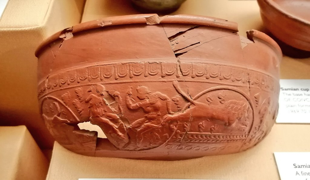 This samian ware bowl was found at Barnwood, #Gloucester, and shows Diana, the #Roman goddess of wild #animals and hunting, with a seated nude male, a dog and a lion. On display at #Cheltenham's Wilson Museum. #MuseumsUnlocked #RomanBritain #RomanArchaeology #Archaeology<br>http://pic.twitter.com/2fxPgyiyNd