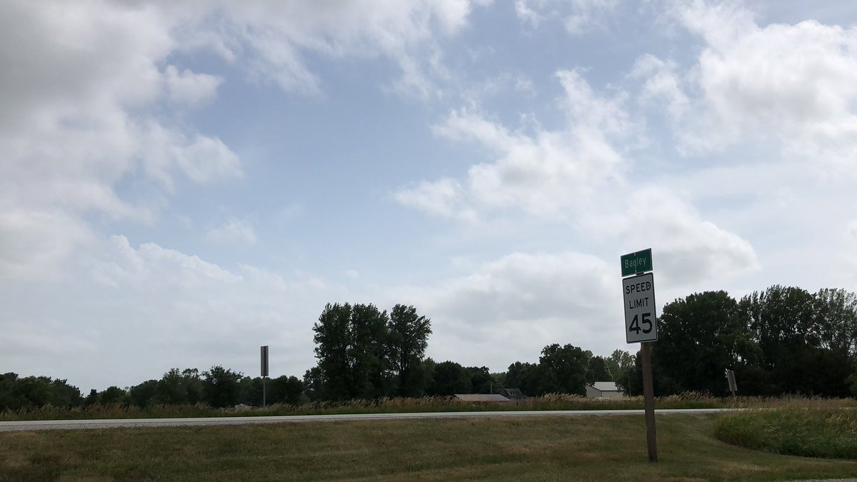 Leaves on trees are turned back. Cumulus field thickening up near Jamaica, IA. Passed a person saying it felt like tornado weather at Casey's in Granger. Feels right, just waiting on some vertical growth along HWY 141. #iawx #stormchasing <br>http://pic.twitter.com/eMtnrnNNrQ