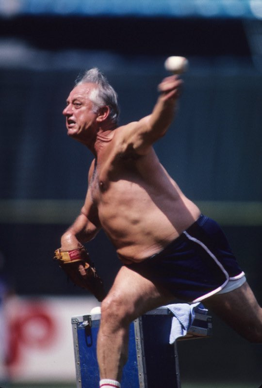 Tommy Lasorda, no shirt, just straight bringing the cheddar.