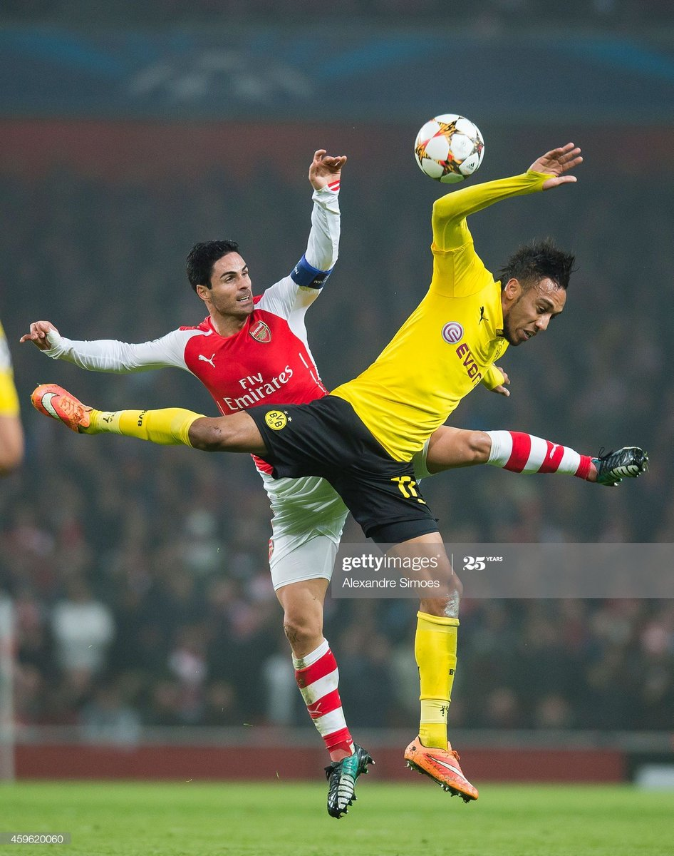 Pierre-Emerick Aubameyang challenges Mikel Arteta in the Champions League, 2014