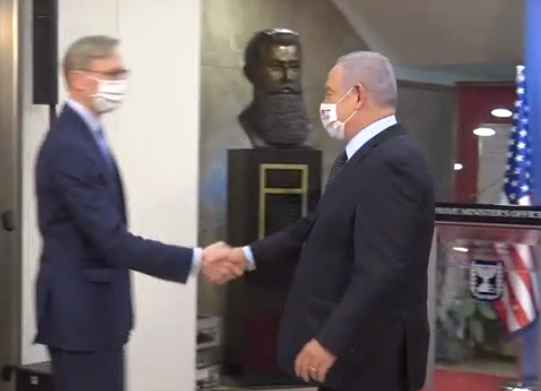 Netanyahu and Brian Hook are wearing masks...but shaking hands