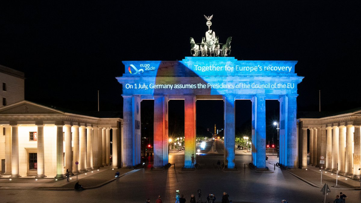 """Germany assumed the six-month Presidency of the Council of the EU at midnight. To mark this occasion, the Brandenburg Gate was lit up with the logo and motto """"Together for Europe's recovery"""". #eu2020de https://t.co/xomNQ5wSiY"""