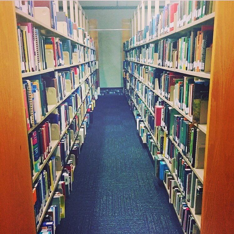 Roaming in #thestacks collecting books for today's curbside pickup orders.   For more information and access to the request form visit our website: https://t.co/zoLRQh1AcV   Questions? Contact: circ_desk@cbu.ca https://t.co/lFaZlFlqjg