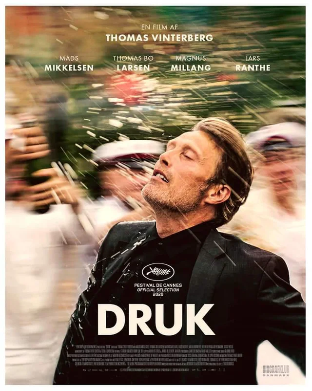Mads Mikkelsen in ecstasy as he gets sprayed with white residue by a bunch of men in unif... oh fuck it you know where this joke is going.