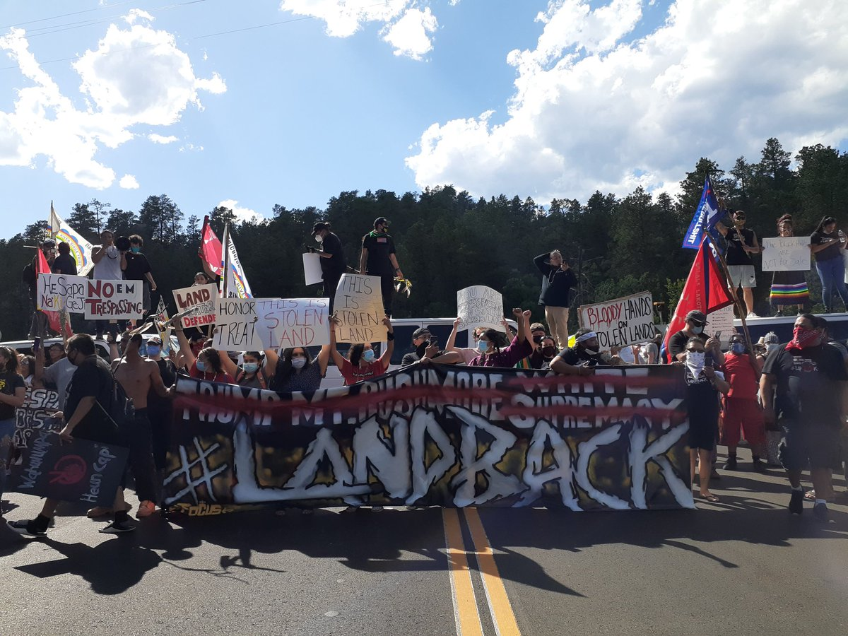 Protesters are now blocking the entrance into Mount Rushmore.