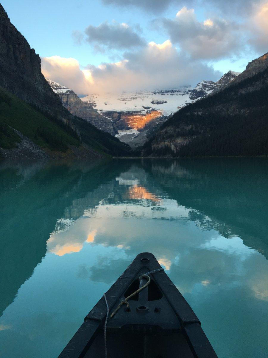 🛶Sunrise canoeing at Lake Louise, Banff National Park, Alberta 🌄 #photo by © Christy