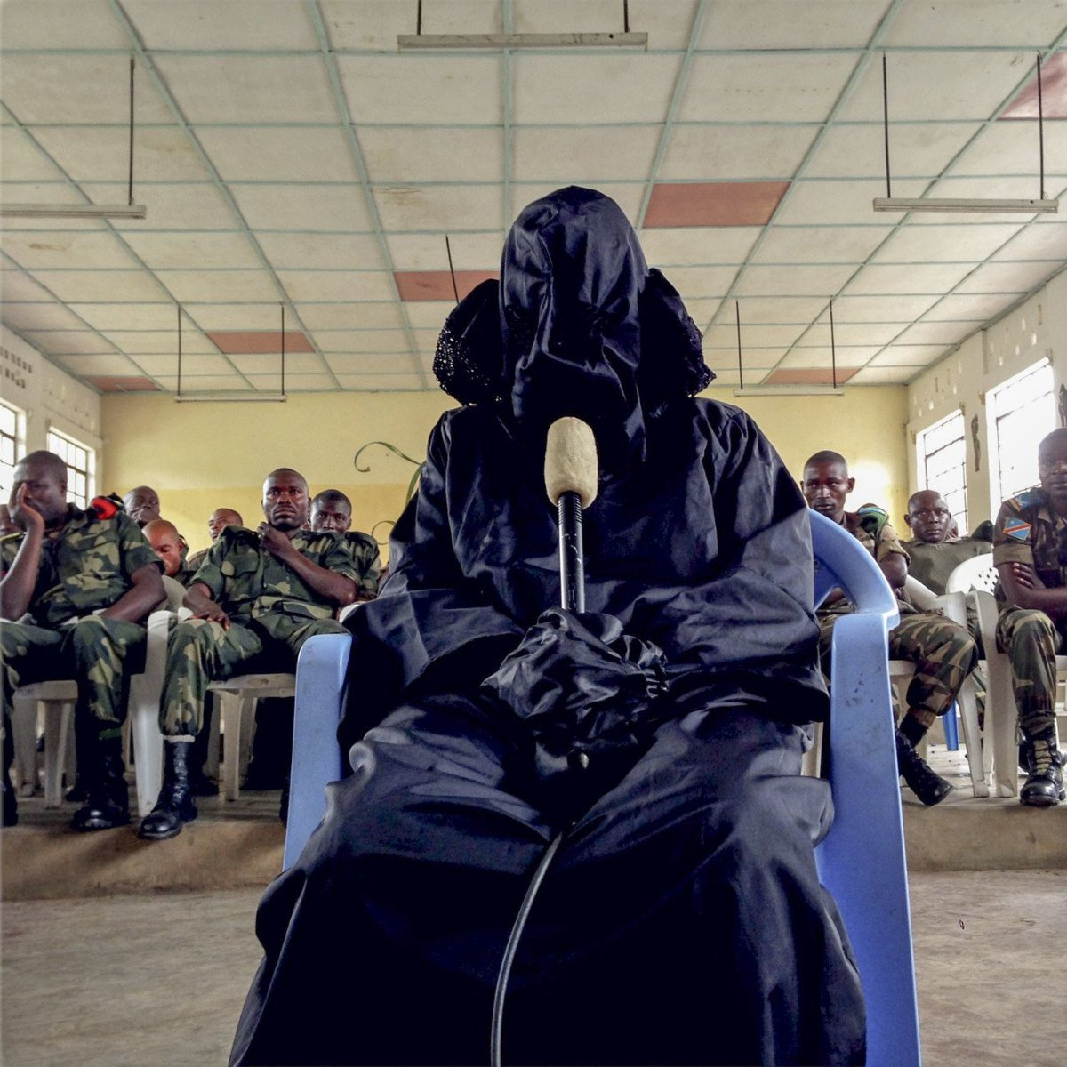 """Democratic Republic of Congo. Minova. 2014. """"A veiled rape survivor testifies while accused Congolese soldiers are sitting behind her."""" phot Michael Christopher Brown <br>http://pic.twitter.com/thBfmq3Vok"""