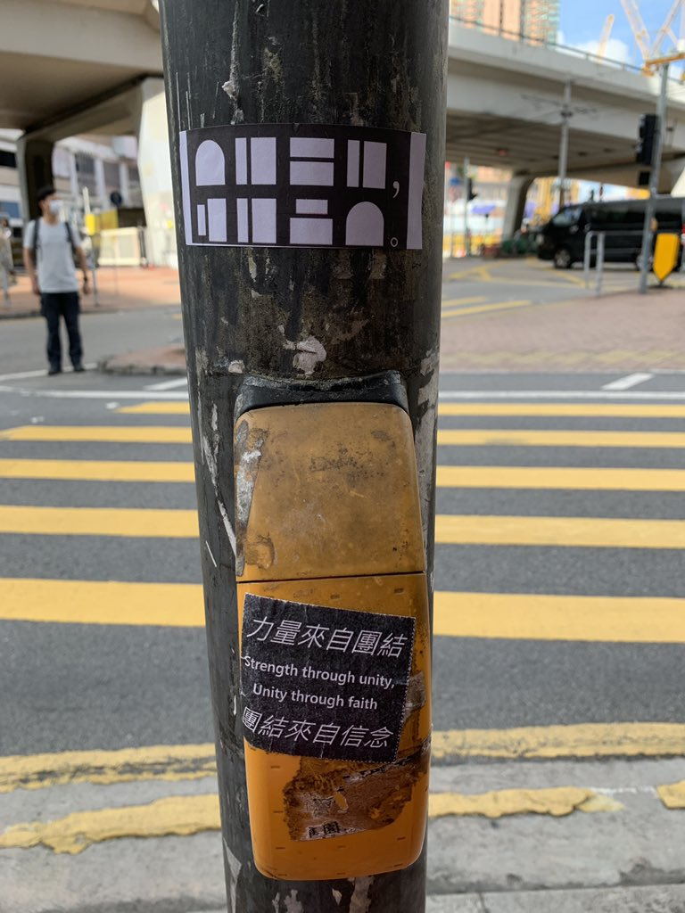 """Just when you thought Hong Kongers have given up chanting the slogan """"Liberate Hong Kong, Revolution of Our Time"""", people have come up with alternative ways to avoid violating the #NationalSecurityLaw. Another sticker reads """"Strength through unity, Unity through faith"""". https://t.co/ymFXq84CD5"""