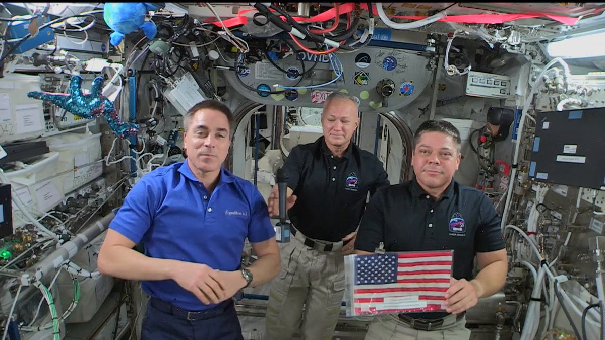 From the @Space_Station, @NASA_Astronauts commemorate the #FourthofJuly. With them is a U.S. flag that flew on the first and last space shuttle missions. @AstroBehnken & @Astro_Doug will bring it back to Earth aboard the SpaceX Dragon Endeavour: youtu.be/0E5r_94EQEk