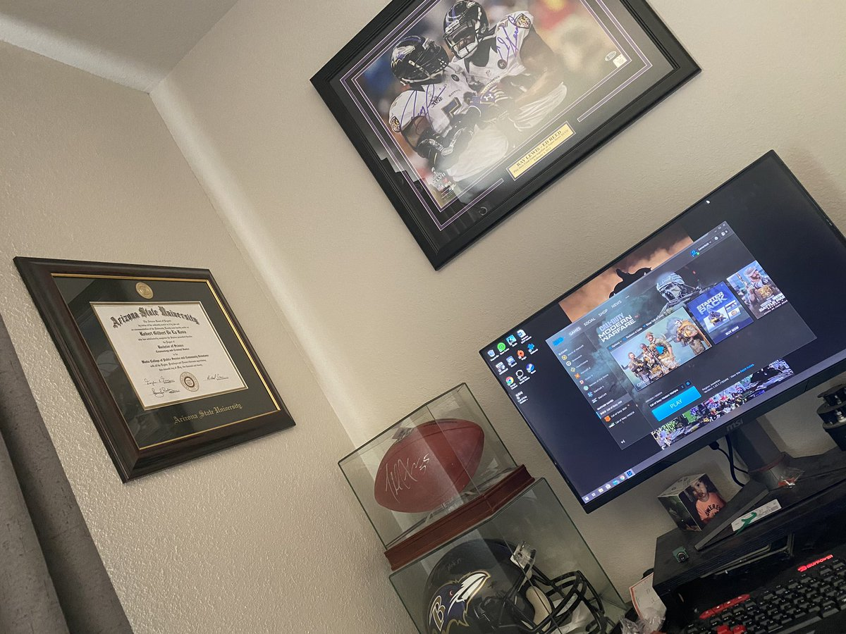 Don't mind me desk but finally hung my degree and my Ed & Ray signed picture #Ravens #RavensFlock @Ravens https://t.co/CwyVDlJq7I