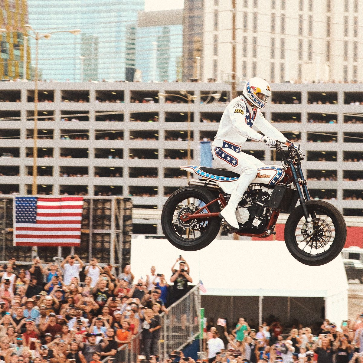 A 52 car #IndependenceDay throwback. Enjoy a safe Fourth of July.  @TravisPastrana jumps an Indian #FTR750 as part of #EvelLive.  #indianmotorcyclepic.twitter.com/ZZ9NcIraNi