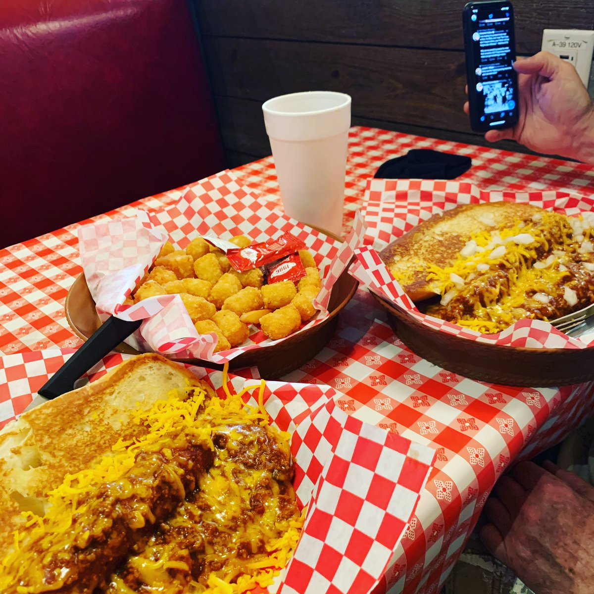 Yummy Coney Dogs and tots🥰 and Steve on his phone😂😂😂